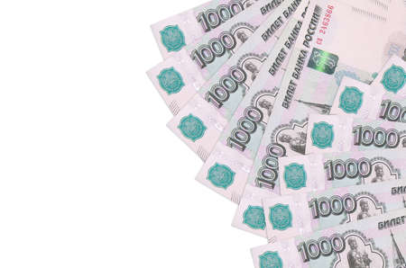 1000 russian rubles bills lies isolated on white background with copy space. Rich life conceptual background. Big amount of national currency wealth