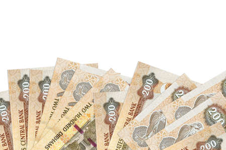 200 UAE dirhams bills lies on bottom side of screen isolated on white background with copy space. Background banner template for business concepts with money