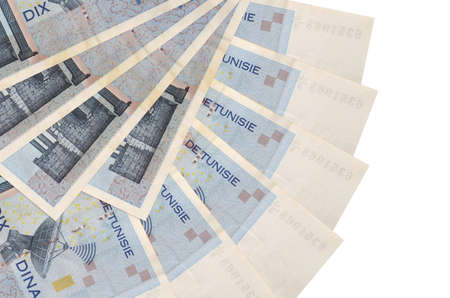 10 Tunisian dinars bills lies isolated on white background with copy space stacked in fan shape close up. Financial transactions concept