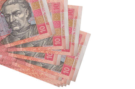 10 Ukrainian hryvnias bills lies in small bunch or pack isolated on white. Mockup with copy space. Business and currency exchange concept