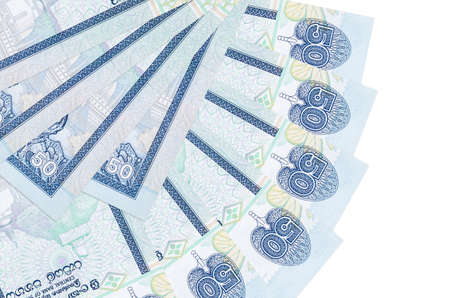 50 Sri Lankan rupees bills lies isolated on white background with copy space stacked in fan shape close up. Financial transactions concept