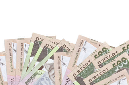 500 Ukrainian hryvnias bills lies on bottom side of screen isolated on white background with copy space. Background banner template for business concepts with money
