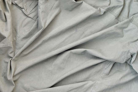The texture of the fabric is olive-colored, which is similar to the uniform of American soldiers of the Second World War. Background image for military design. Stock Photo