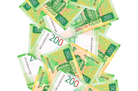 200 russian rubles bills flying down isolated on white. Many banknotes falling with white copy space on left and right side