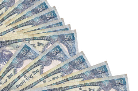 50 Nepalese rupees bills lies isolated on white background with copy space stacked in fan close up. Payday time concept or financial operations