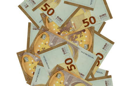 50 euro bills flying down isolated on white. Many banknotes falling with white copy space on left and right side