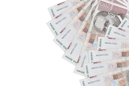 200 Croatian kuna bills lies isolated on white background with copy space. Rich life conceptual background. Big amount of national currency wealth Zdjęcie Seryjne