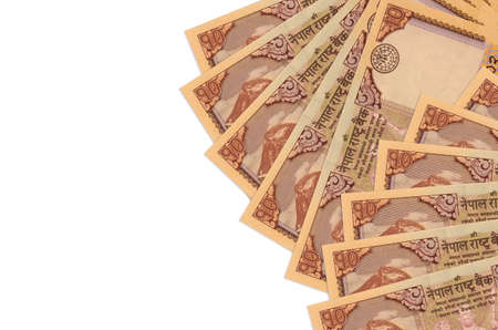 10 Nepalese rupees bills lies isolated on white background with copy space. Rich life conceptual background. Big amount of national currency wealth