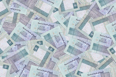 5 Egyptian pounds bills lies in big pile. Rich life conceptual background. Big amount of money
