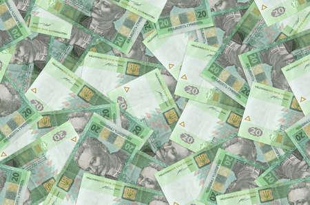 20 Ukrainian hryvnias bills lies in big pile. Rich life conceptual background. Big amount of money