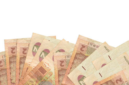 2 Ukrainian hryvnias bills lies on bottom side of screen isolated on white background with copy space. Background banner template for business concepts with money