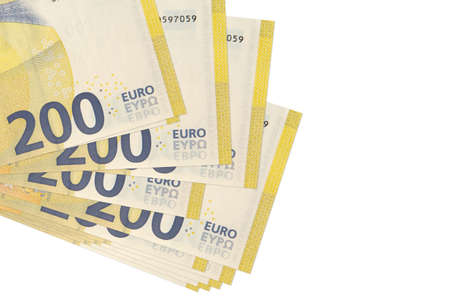 200 euro bills lies in small bunch or pack isolated on white. Mockup with copy space. Business and currency exchange concept Zdjęcie Seryjne