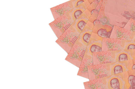 100 Thai baht bills lies isolated on white background with copy space. Rich life conceptual background. Big amount of national currency wealth Zdjęcie Seryjne