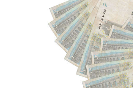 5 euro bills lies isolated on white background with copy space. Rich life conceptual background. Big amount of national currency wealth