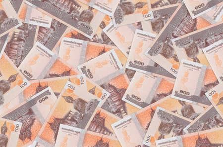 100 Cambodian riels bills lies in big pile. Rich life conceptual background. Big amount of money