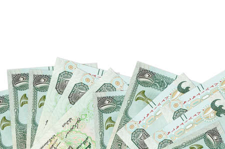 10 UAE dirhams bills lies on bottom side of screen isolated on white background with copy space. Background banner template for business concepts with money