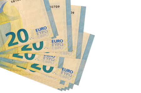 20 euro bills lies in small bunch or pack isolated on white. Mockup with copy space. Business and currency exchange concept