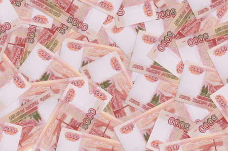 5000 russian rubles bills lies in big pile. Rich life conceptual background. Big amount of money