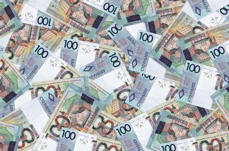 100 Belorussian rubles bills lies in big pile. Rich life conceptual background. Big amount of money
