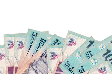 1000 Indonesian rupiah bills lies on bottom side of screen isolated on white background with copy space. Background banner template for business concepts with money