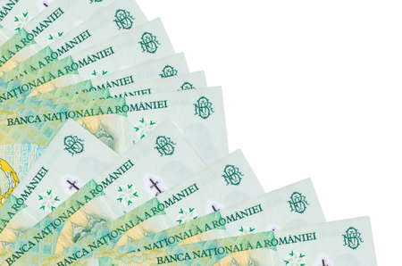 1 Romanian leu bills lies isolated on white background with copy space stacked in fan close up. Payday time concept or financial operations