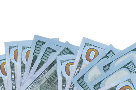 100 US dollars bills lies on bottom side of screen isolated on white background with copy space. Background banner template for business concepts with money