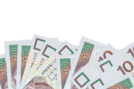 10 Polish zloty bills lies on bottom side of screen isolated on white background with copy space. Background banner template for business concepts with money