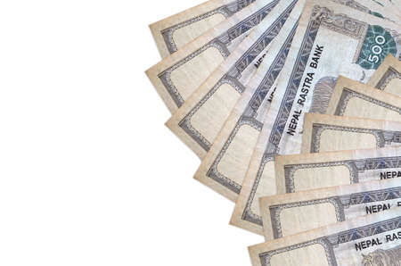500 Nepalese rupees bills lies isolated on white background with copy space. Rich life conceptual background. Big amount of national currency wealth