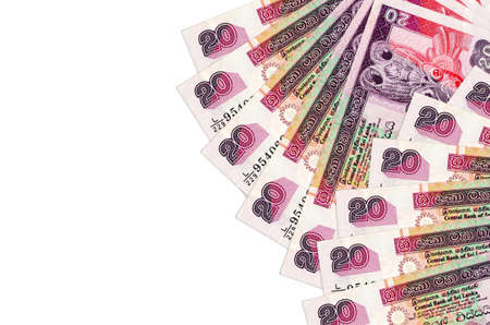 20 Sri Lankan rupees bills lies isolated on white background with copy space. Rich life conceptual background. Big amount of national currency wealth
