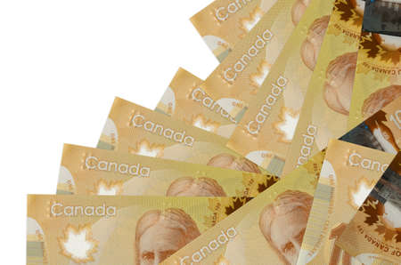 100 Canadian dollars bills lies in different order isolated on white. Local banking or money making concept. Business background banner