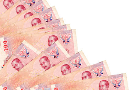 100 Thai Baht bills lies isolated on white background with copy space stacked in fan close up. Payday time concept or financial operations