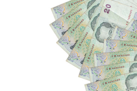 20 Thai Baht bills lies isolated on white background with copy space. Rich life conceptual background. Big amount of national currency wealth 免版税图像