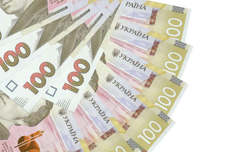 100 Ukrainian hryvnias bills lies isolated on white background with copy space stacked in fan shape close up. Financial transactions concept