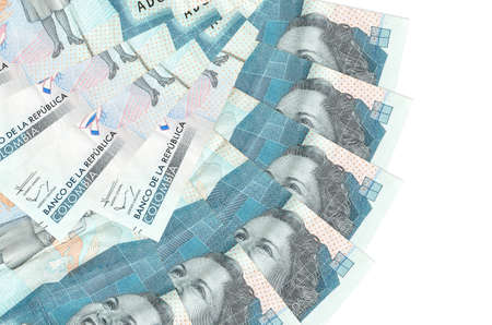 2 Colombian pesos bills lies isolated on white background with copy space stacked in fan shape close up. Financial transactions concept