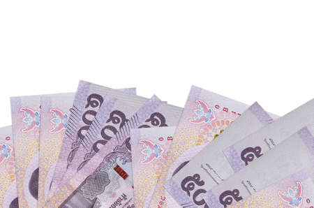 500 Thai baht bills lies on bottom side of screen isolated on white background with copy space. Background banner template for business concepts with money