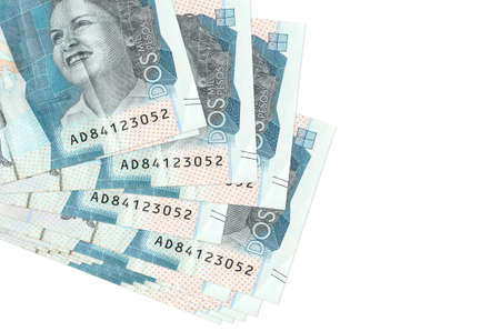 2 Colombian pesos bills lies in small bunch or pack isolated on white. Mockup with copy space. Business and currency exchange concept