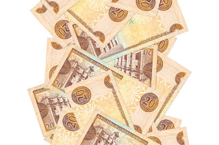 20 Dominican peso bills flying down isolated on white. Many banknotes falling with white copy space on left and right side