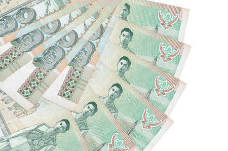 20 Thai Baht bills lies isolated on white background with copy space stacked in fan shape close up. Financial transactions concept