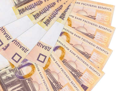 20 Belorussian rubles bills lies isolated on white background with copy space stacked in fan shape close up. Financial transactions concept