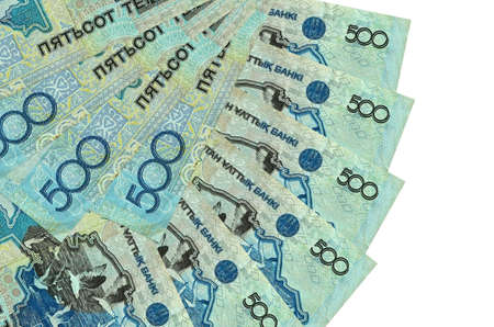 500 Kazakhstani tenge bills lies isolated on white background with copy space stacked in fan shape close up. Financial transactions concept