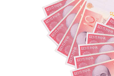 10 Estonian kroon bills lies isolated on white background with copy space. Rich life conceptual background. Big amount of national currency wealth