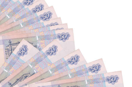 50 russian rubles bills lies isolated on white background with copy space stacked in fan close up. Payday time concept or financial operations 免版税图像
