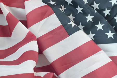 United States of America waving flag with many folds. Patriotic background for USA Memorial Day design Foto de archivo