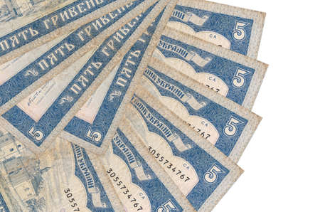 5 Ukrainian hryvnias bills lies isolated on white background with copy space stacked in fan shape close up. Financial transactions concept