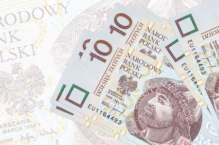 10 Polish zloty bills lies in stack on background of big semi-transparent banknote. Abstract presentation of national currency. Business concept Stock fotó