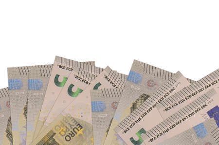 5 euro bills lies on bottom side of screen isolated on white background with copy space. Background banner template for business concepts with money