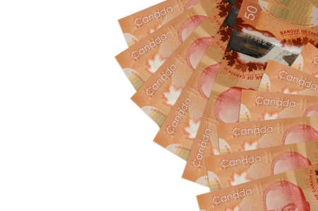 50 Canadian dollars bills lies isolated on white background with copy space. Rich life conceptual background. Big amount of national currency wealth