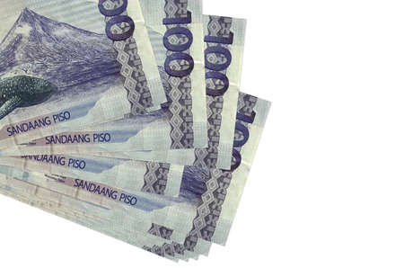 100 Philippine piso bills lies in small bunch or pack isolated on white. Mockup with copy space. Business and currency exchange concept Archivio Fotografico