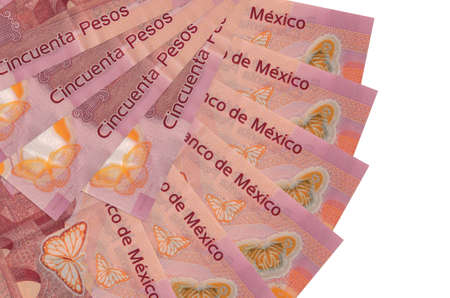 50 Mexican pesos bills lies isolated on white background with copy space stacked in fan shape close up. Financial transactions concept
