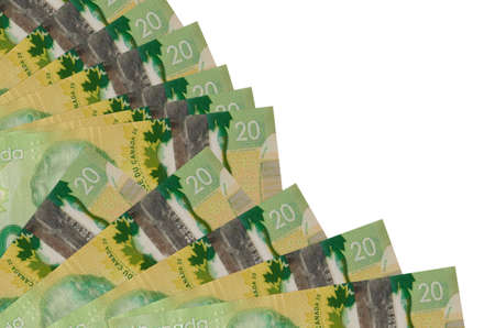 20 Canadian dollars bills lies isolated on white background with copy space stacked in fan close up. Payday time concept or financial operations
